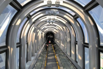 <p>Inside the glass-enclosed&nbsp;escalator shaft. It is reported to be the highest escalator in the world and offers great views of the city while floating in space.</p>