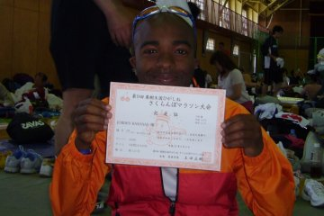 Proudly showing proof of the completed 2010 Sakuranbo Marathon