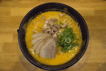 <p>First day: Spicy miso ramen, with generous servings of charshu slices and pork cubes.</p>
