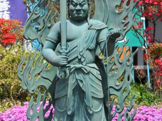 Fudo-myoo greets guests at the main hall of this Buddhist temple of the Shingon sect.