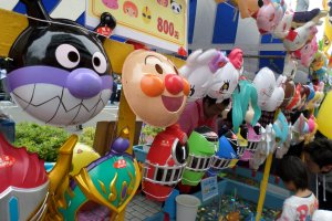"Also for sale were toys and trinkets, including masks from popular kids' shows like ""Anpanman"" and ""Super Sentai."""