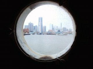 Nearby Minato Mirai 21 seen through one of the ship's portholes.