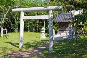 In the large grassy area of Tateyama Castle is this torii gate and shrine.