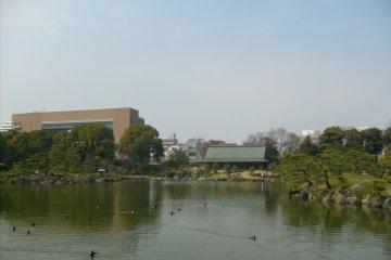 <p>The view across the pond to the Taisho Kinenkan</p>