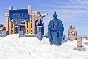 Some religious statues and a Shrine at the peak of 'Ken-ga-mine'