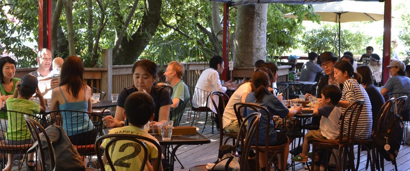 In the evening, the cafe's riverside deck is lit up by candlelight