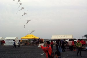 A series of connected kites carry messages of hope towards the heavens