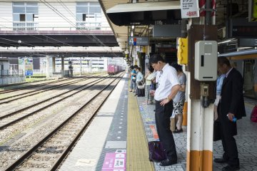<p>Commuters waiting for the trains at Hachioji Station</p>