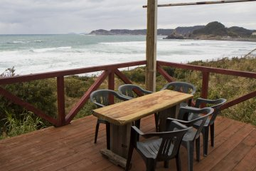 <p>Outdoor seating looks onto the incoming waves</p>