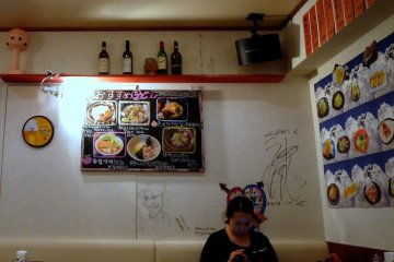<p>There are pictures of the food on the wall with both Japanese and English</p>