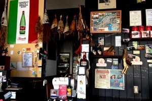 Dried ham and various food items decorate this Italian eatery