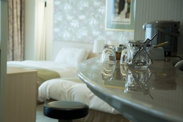 <p>The bar and two more beds available in the suite</p>