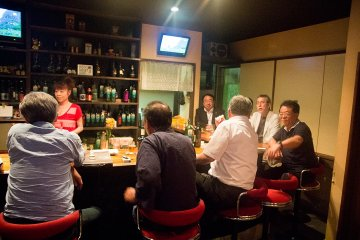 <p>Enjoy a drink and karaoke in the local Snack bar</p>