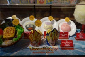 Window preview of Dragon Ball-themed food items inside J-WORLD Kitchen