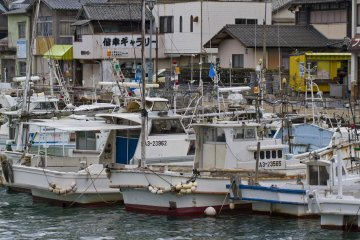 <p>The harbor is packed with interesting fishing vessels to explore from the town streets</p>