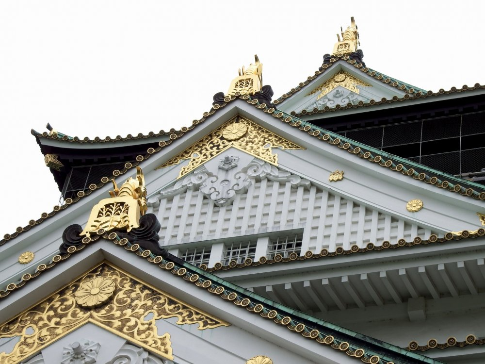 Beautiful gold decoration on the castle roof