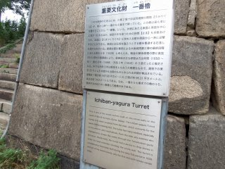 According to the sign, this is called the 'Ichiban-yagura' turret, the first turret of seven turrets built on the stone walls on the south side of the Outer Bailey. It was built in 1628 and only two out of seven turrets remain, which makes it an important cultural property of Japan. The turret has many windows for the purpose of attacking enemies from them. Also, it has a device to drop stones to repel enemies who attempt to climb the stone walls