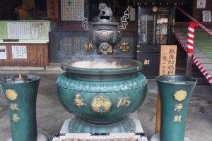 Burning incense outside a shrine