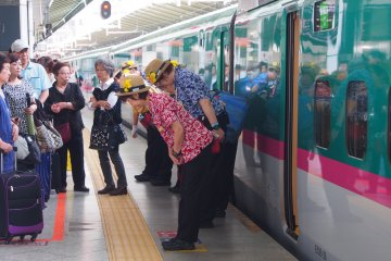 <p>The colourful, super-efficient Shinkansen cleaning staff</p>