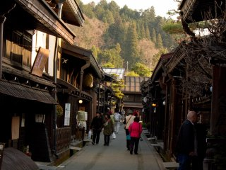 Whole streets are lined with the historic wooden buildings that usually host little shops selling local products like miso paste or sake in particular. There is a lot of sampling going on, you should definitely try!