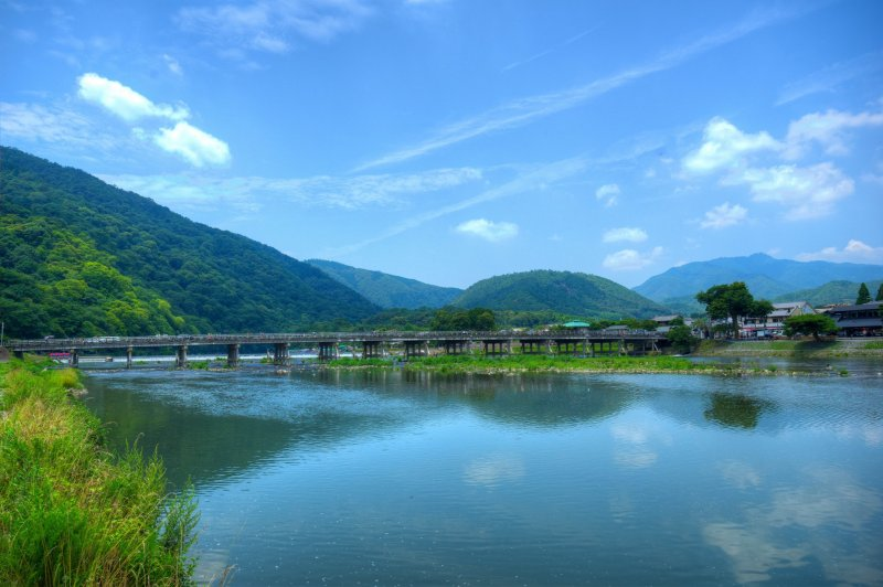 <p>Togetsukyo Bridge framed by dramatic mountains.</p>