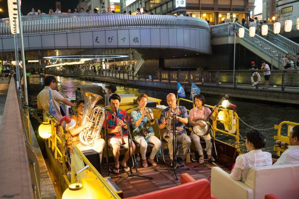 You can take a pleasure boat along the canal with live music.