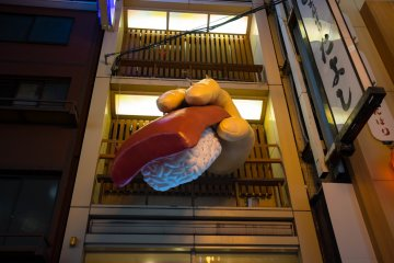<p>Everything is larger than life here, including this huge sushi sign.</p>