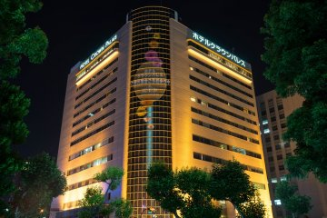 <p>Hotel illuminated at night</p>