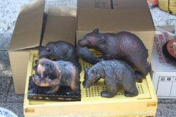 <p>Wooden bear carvings</p>