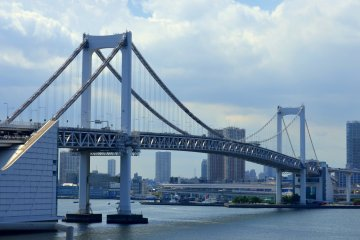 <p>The Rainbow Bridge carries three transportation lines, which are for rail, motor vehicles and pedestrians! Walking along the bridge, as the trains and large vehicles zoom by can be very exciting!</p>