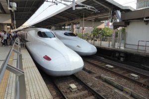 Two Shinkansen heading in opposite directions at Nagoya Station