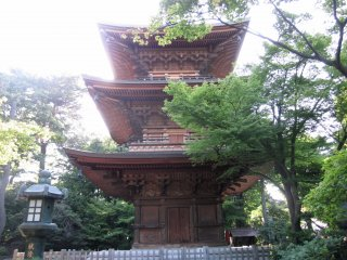 "The three-tiered pagoda, referred to in Japanese as sanju-no-to. On the second tier, you can see two hidden cats placed. Pagodas always have an uneven number of tiers and are known as the ""house of worship"" making it a desired attraction on temple grounds."