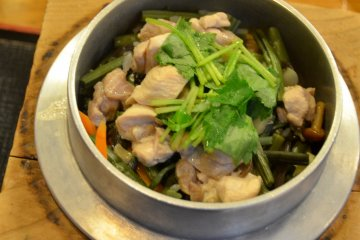 <p>Jidori Sansai - a recommended Kyoto dish that comprises fragrant rice, chicken and wild vegetables. &nbsp;</p>