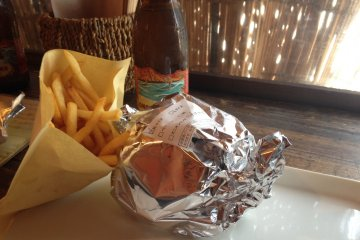 <p>Burgers arrive wrapped in foil to prevent any juices escaping</p>