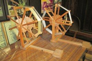 A silk spinning wheel inside the farmhouse from Hyuga Shiiba in Miyazaki Prefecture