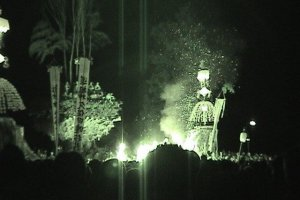 In this night vision shot you can see the men on the top of the pyre. What looks like lines of smoke above them is actually bamboo, stuck into the top of the pyre.