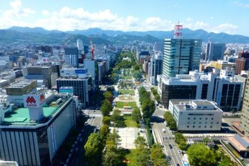 <p>The beautiful view out to Odori Park and beyond from the observatory of the Sapporo Tower</p>