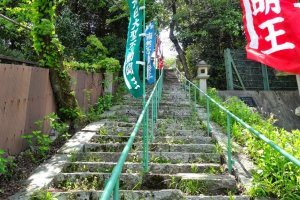 another temple with a set of stone steep steps adorned with colorful flags that led up to a small quiet temple.