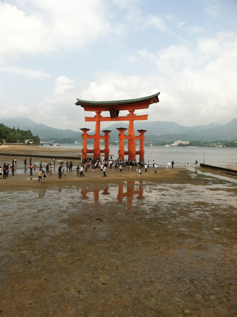 <p>Miyajima&#39;s&nbsp;famous torii is visible behind the stage</p>
