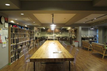 <p>The large dining table can seat over 20 people</p>