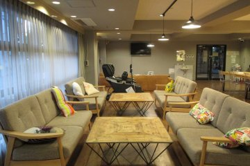 <p>The lounge is next to the kitchen and has a massage chair</p>