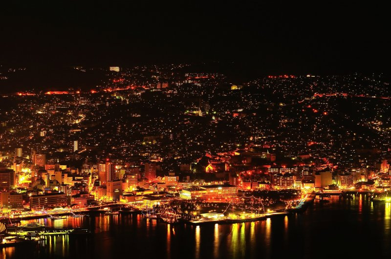 <p>Shimmering city of gold at night, Nagasaki: This city has prospered through trade with European countries, China and Russia since olden times</p>