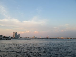 Folks gather at the harbor to watch the sunset in Minato Mirai 21