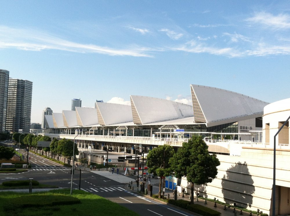 The PacificoExhibition Hall's design stands out among Yokohama's tall towers