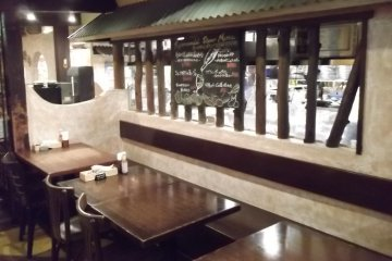 <p>From these tables you can watch the kitchen staff</p>