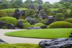 Summer view of the Dry Landscape Garden, anchored by massive stones