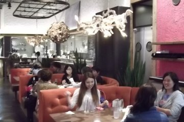<p>The central part of the cafe, with comfy-looking couches</p>