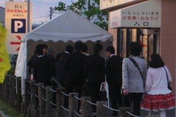 As the sun set, the queue grew