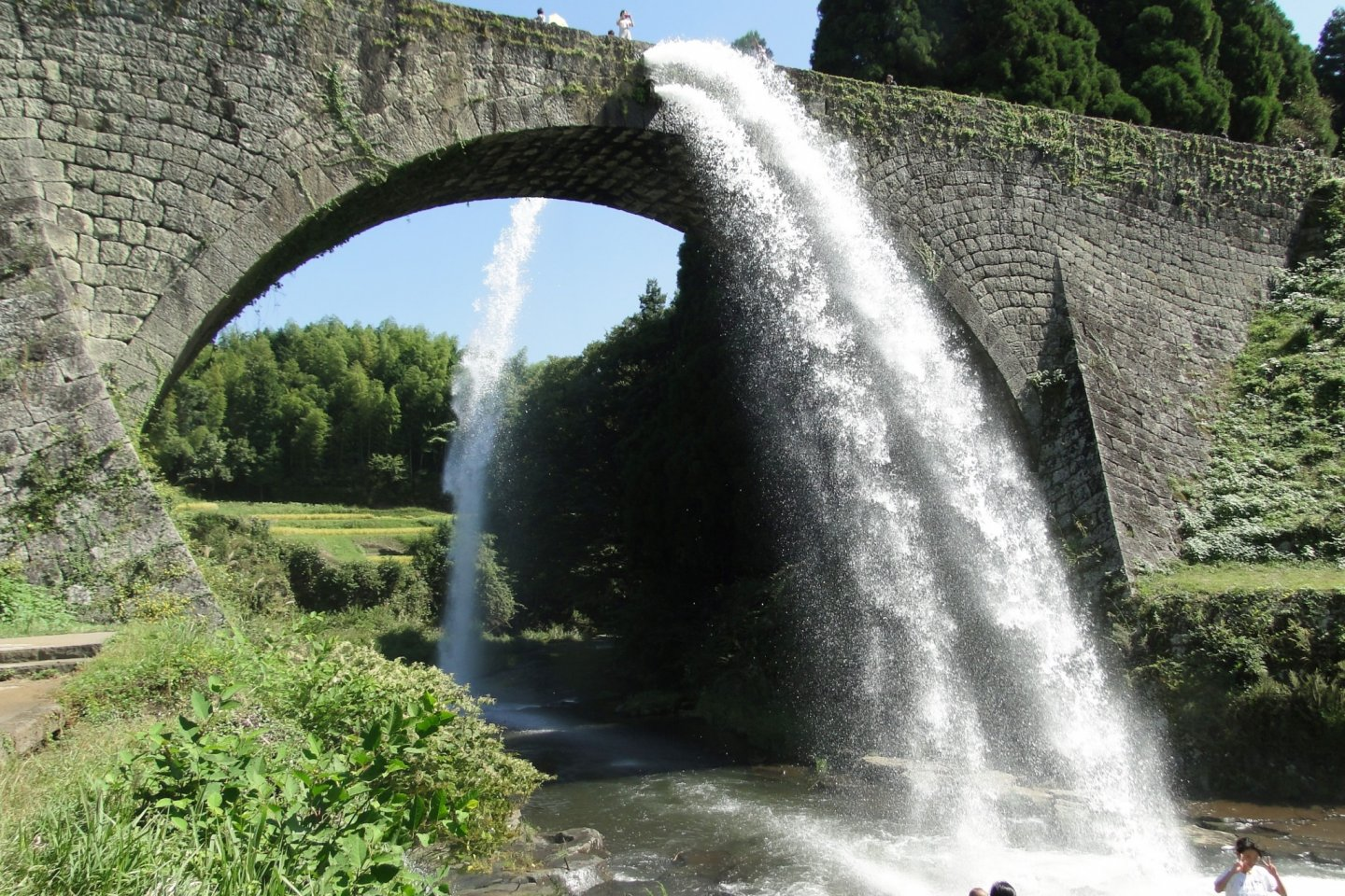 Water pours forth from the Tsjunkyo Aqueduct in rural Kumamoto
