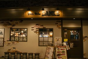Beer Hall Danke's front design is very inviting with its cool looking beer kegs in front.